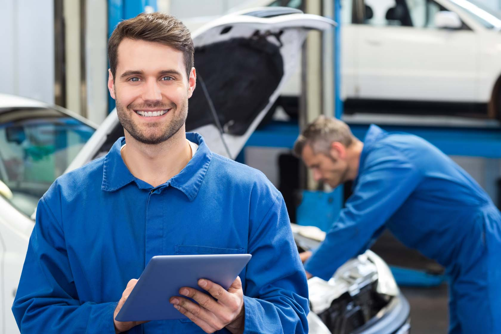 motor mechanics servicing a car at rockhampton